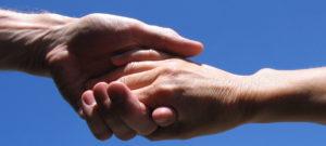 Coaching: Twee handen in elkaar: ik reik je als coach de hand om je te helpen.